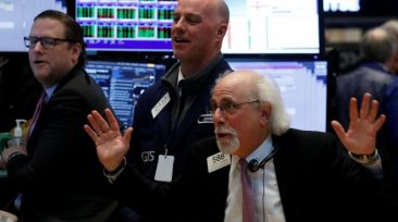 Traders joke around on the floor of the New York Stock Exchange (NYSE) in New York, U.S., March 10, 2017. REUTERS/Brendan McDermid