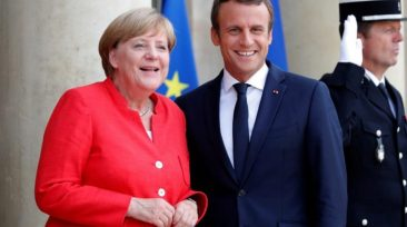 French President Emmanuel Macron (R) greets German Chancellor Angela Merkel as she arrives for talks on EU integration, defense and migration at the Elysee Palace in Paris, France, August 28, 2017.  REUTERS/Charles Platiau