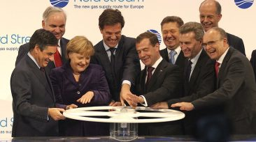 (From left to right, first row) French Prime Minister Francois Fillon; German Chancellor Angela Merkel; Dutch Prime Minister Mark Rutte; Russian President Dmitry Medvedev; and European Union Energy Commissioner Guenther Oettinger turn a wheel to symbolically start the flow of gas through Line 1 of the Nord Stream twin pipeline system. (From left to right, back row) Dr. Johannes Teyssen, Chairman of the Board of Management, E.ON AG; Alexei Miller, Deputy Chairman of the Board of Directors and Chairman of the Management Committee of OAO Gazprom; Dr. Kurt Bock, Chairman of the Board of Executive Directors, BASF SE; and Erwin Sellering, Minister President of Mecklenburg-Western Pomerania.